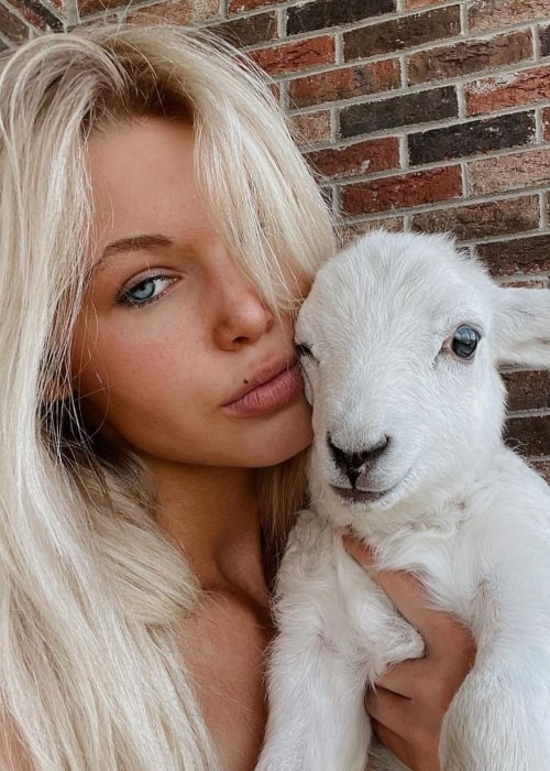 Genevieve Madison as seen in a selfie with a sheep in Burgin, Kentucky in March 2021