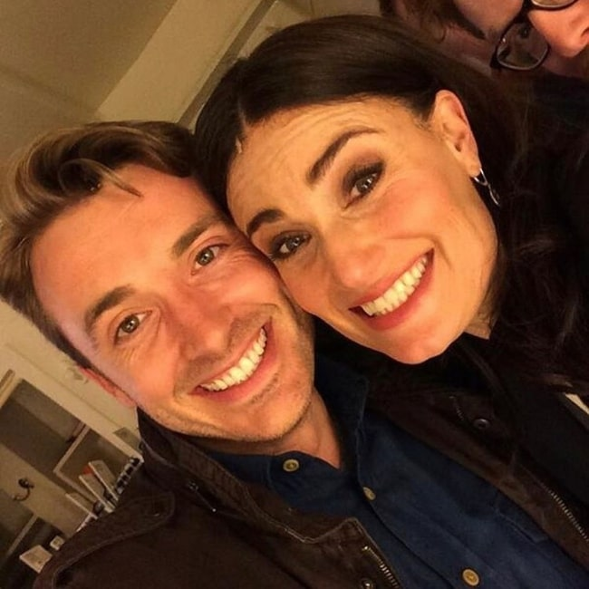 James Snyder smiling in a selfie alongside Idina Menzel in New York City, New York in March 2020