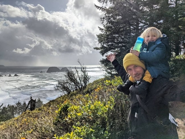 John Robinson with his son in Cape Meares, Oregon in March 2021