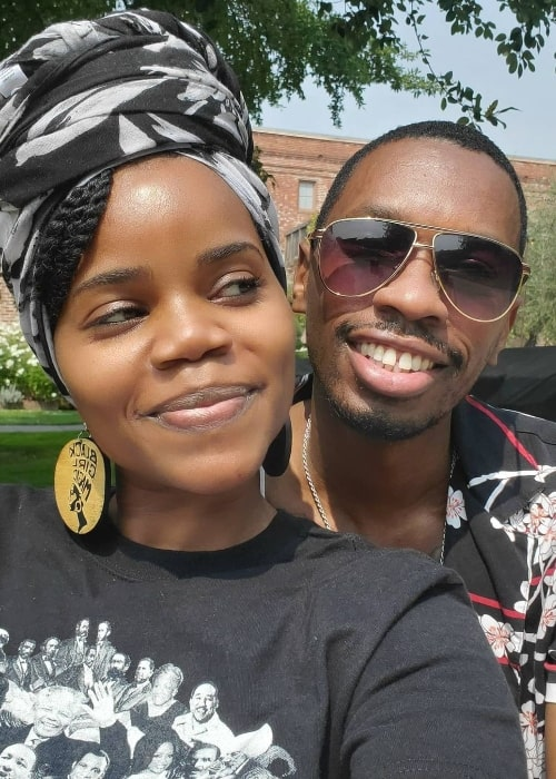Kelly Jenrette smiling for a selfie alongside Melvin Jackson Jr.