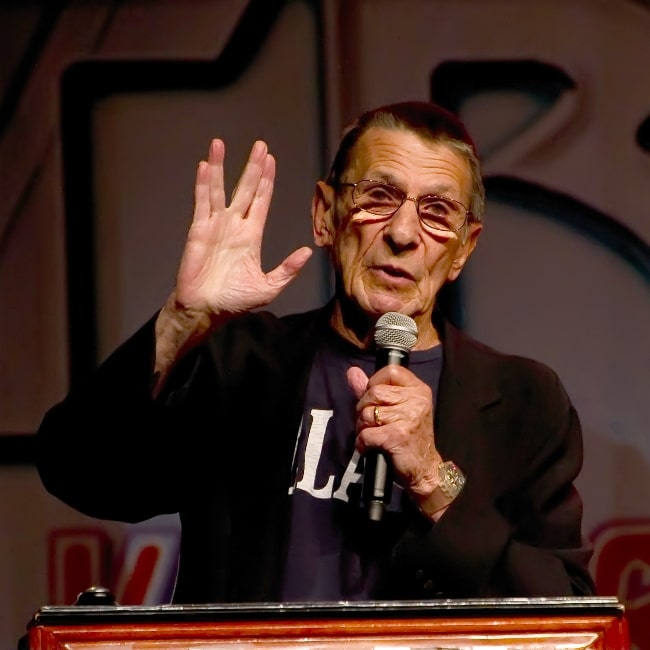Leonard Nimoy pictured while giving the Vulcan salute at the Las Vegas Star Trek Convention 2011