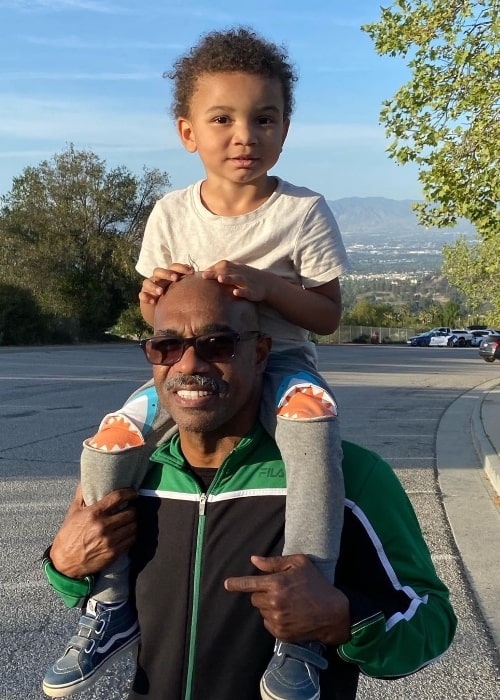 Michael Beach with his child in 2021