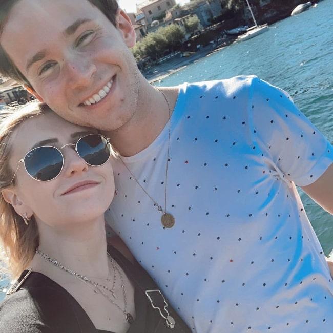 Nicholas Podany smiling in a selfie alongside Crystal Lake Evans