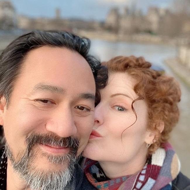 Rebecca Wisocky and husband Lap Chi Chu in a selfie in December 2019