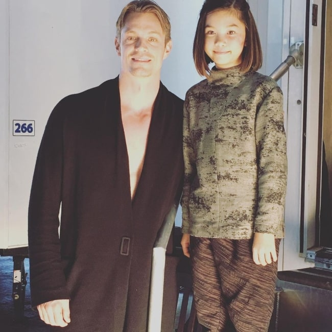 Riley Lai Nelet smiling for a picture alongside Joel Kinnaman