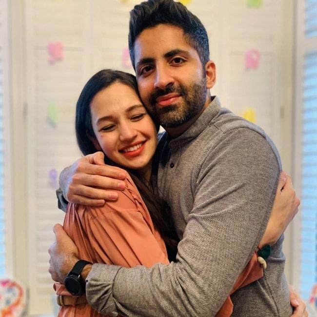 Suhani Dhanki smiling for the camera alongside her husband Prathmesh Mody