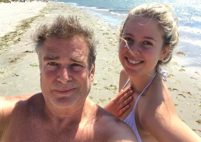Aliya Kapoor smiling in a selfie with her father at West Wittering Beach in West Wittering, England in July 2018