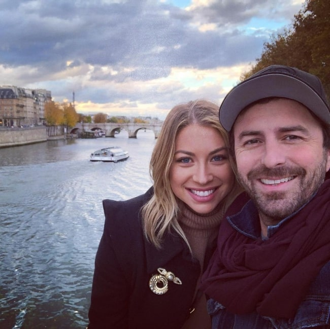 Beau Clark smiling in a selfie alongside Stassi Schroeder in Paris, France