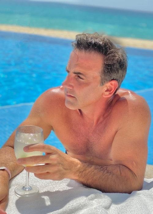 Carlos Ponce posing shirtless at Le Blanc Spa Resort Los Cabos in Mexico