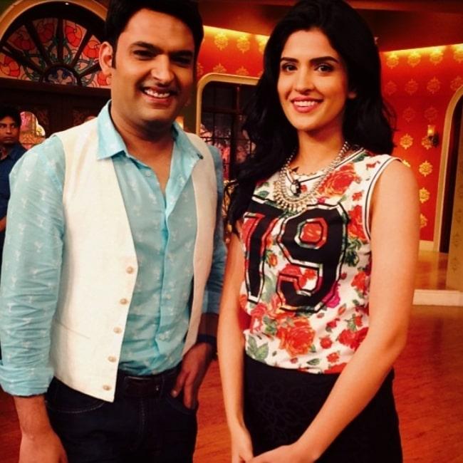 Deeksha Seth as seen in a picture with comedian Kapil Sharma in June 2014