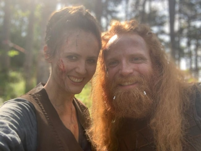 Emily Cox smiling in a selfie alongside Magnus Bruun in June 2019