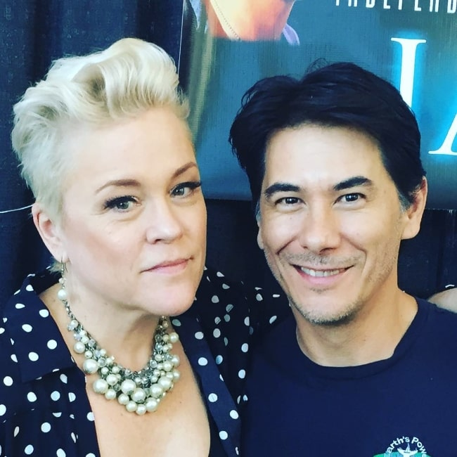 James Duval smiling for a picture alongside Christine Elise McCarthy at Burbank Marriott Convention Center in September 2018