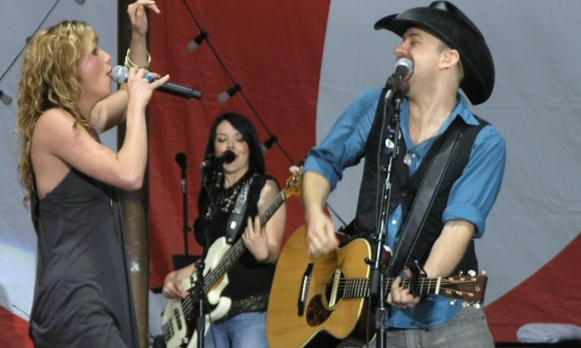 Jennifer Nettles and Kristian Bush (foreground) with Annie Clements (background) perform at MyCokeFest at Centennial Olympic Park in Atlanta, Georgia in April 2007
