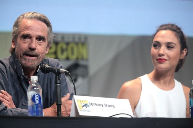 Jeremy Irons and Gal Gadot speaking at the 2015 San Diego Comic Con International, for 'Batman v Superman Dawn of Justice', at the San Diego Convention Center in San Diego, California