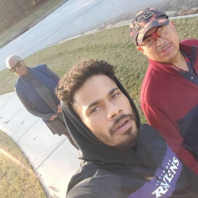 Jordan Calloway clicking a selfie with his parents