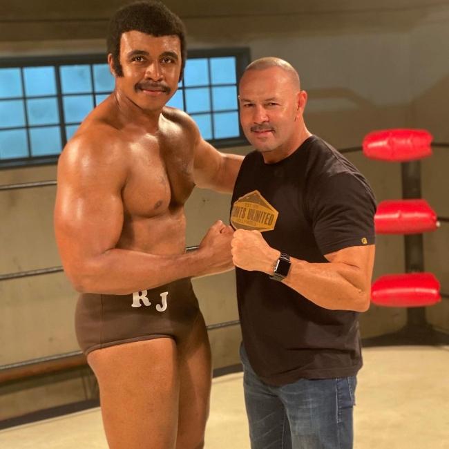 Joseph Lee Anderson (Left) posing for a picture alongside Chavo Guerrero Jr.