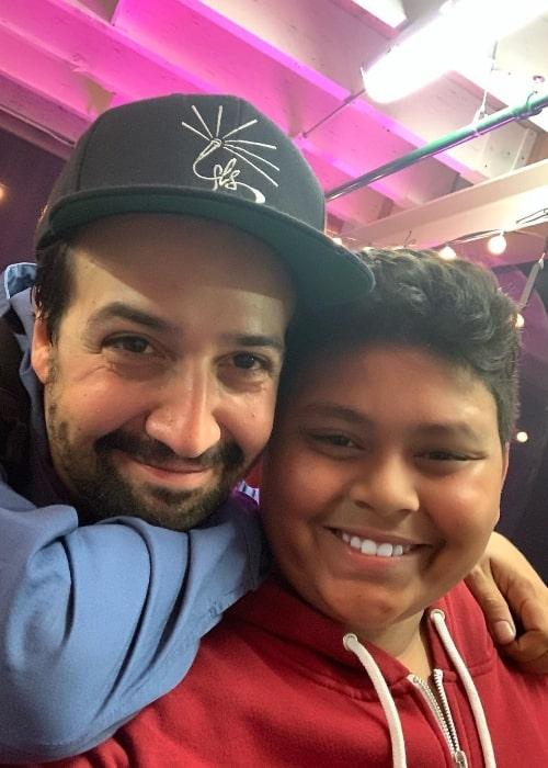 Luke Islam (Right) smiling for a picture alongside Lin-Manuel Miranda in October 2019