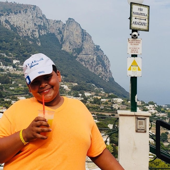 Luke Islam as seen while smiling for a picture in Italy
