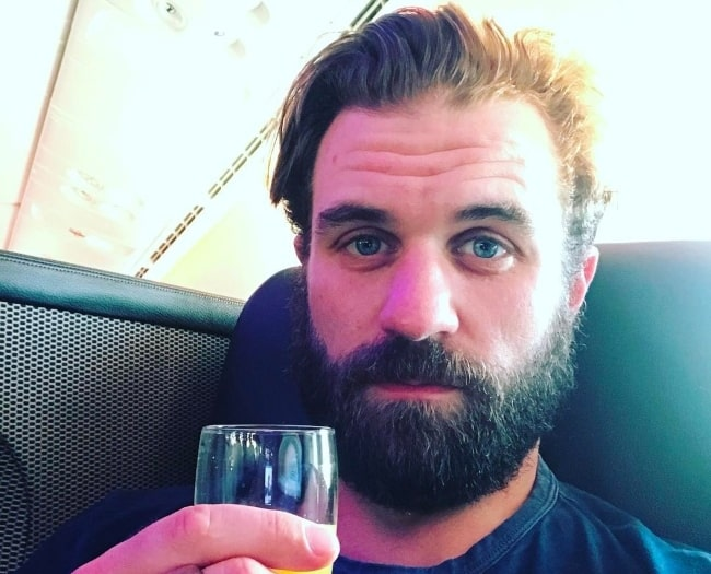 Milo Gibson in February 2017 saying cheers to himself and his beard