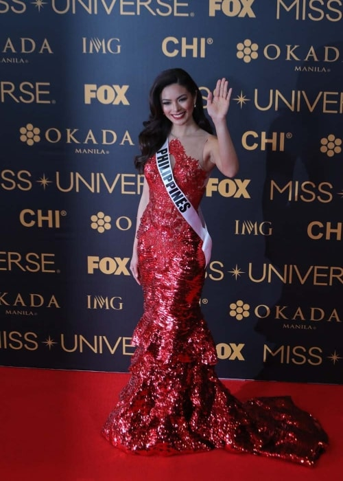 Miss Universe Philippines Maxine Medina waves to the media during the Miss Universe Red Carpet event on January 30, 2017, at the SMX Convention Center in Pasay City