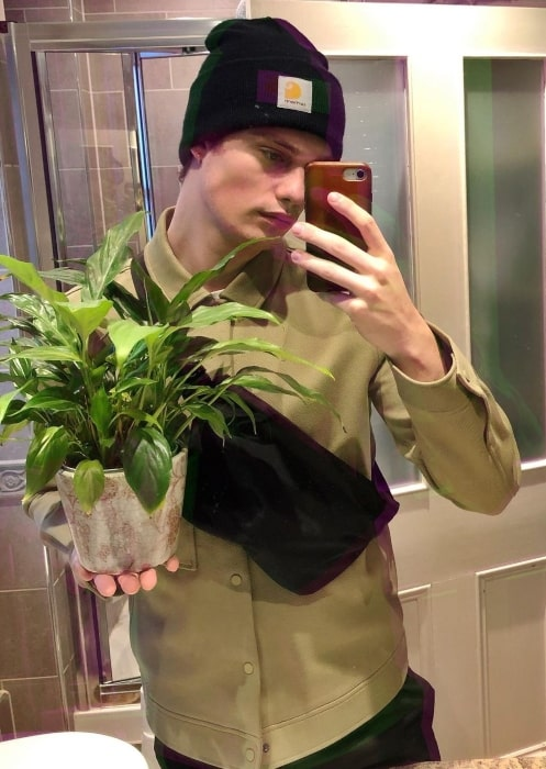 Nicholas Galitzine busy with potted plants in January 2020