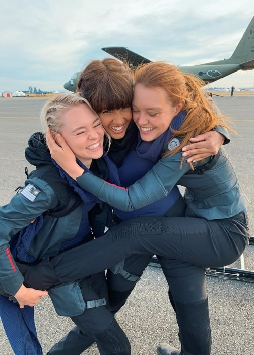 Taylor Hickson as seen in a picture with actress Jessica Sutton and Ashley Nicole Williams on the set of Motherland Fort Salem in May 2020