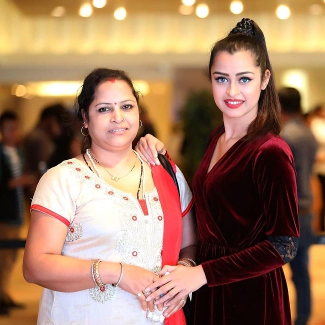 Apsara Rani and her mother posing for the camera