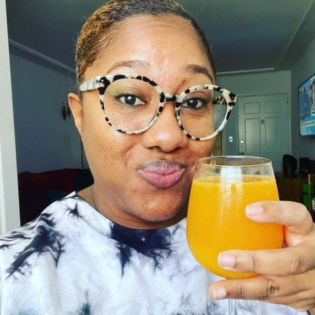 Ashley Nicole Black raising a toast in November 2020