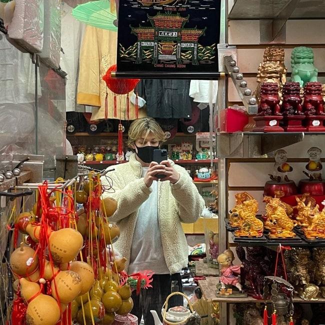 Jacob Hurley Bongiovi taking a mirror selfie while walking around in New York City, New York in December 2020