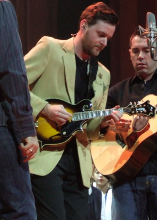 Kevin Hearn plays the mandolin at Massey hall with fellow Barenaked Ladies, Steven Page (left) and Ed Robertson (right) in November 2005