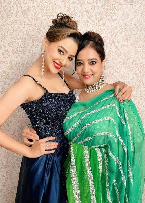 Madalsa Sharma smiling for a picture alongside her mother Sheela Sharma