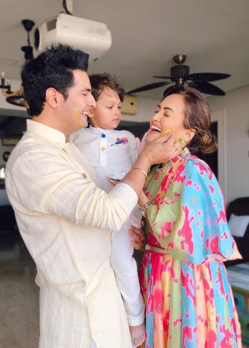 Nisha Rawal as seen while smiling in a Holi picture with Karan Mehra and their son in March 2021