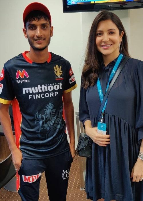 Shahbaz Ahmed posing for a picture alongside Anushka Sharma at Dubai International Cricket Stadium in October 2020