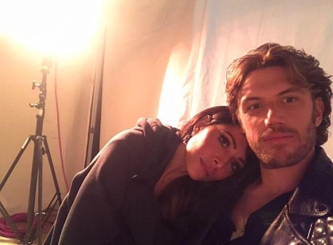 Adam Demos in a selfie with Sarah Shahi in February 2021