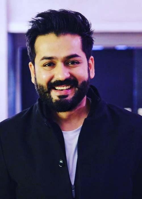 Aditya Dhar as seen smiling in 2019