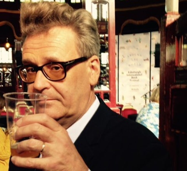 Greg Proops in April 2020 stating he is not watching