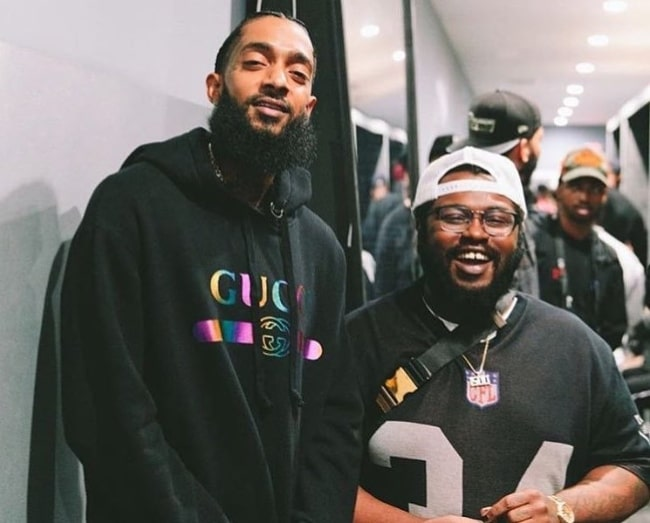 James Fauntleroy (Right) smiling for the camera alongside Nipsey Hussle