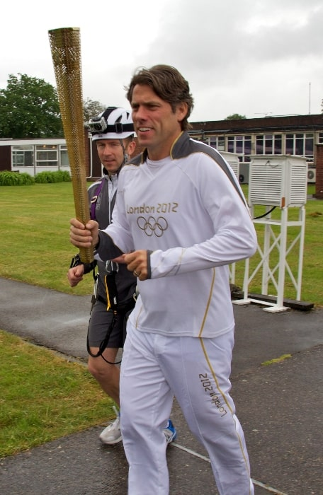 John Bishop pictured while carrying the Olympic Torch at Jodrell Bank in 2012