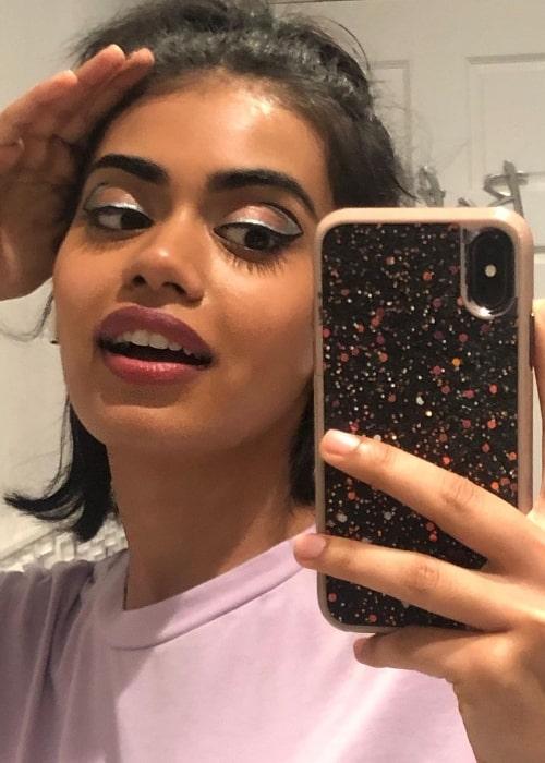 Megan Suri taking a mirror selfie in April 2021