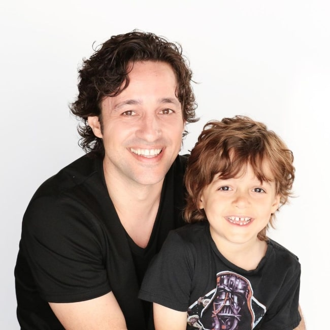 Nolan River smiling for a picture alongside his father Thomas Nicholas