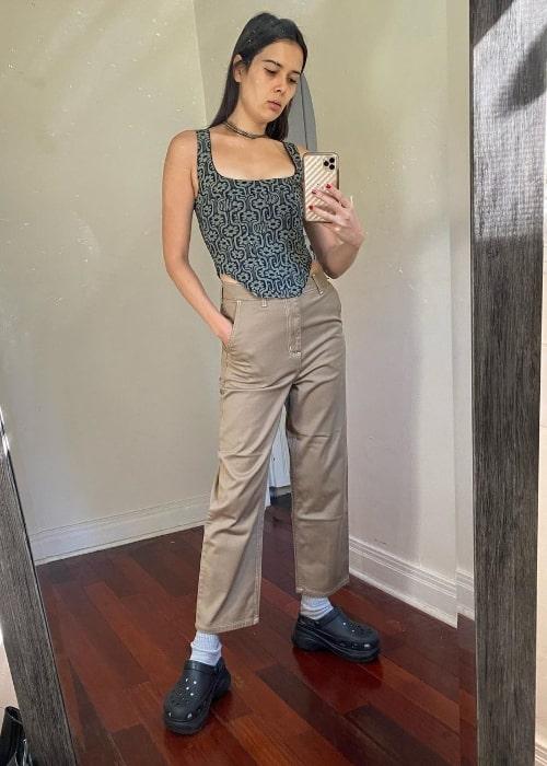 Patti Harrison taking a mirror selfie in February 2021