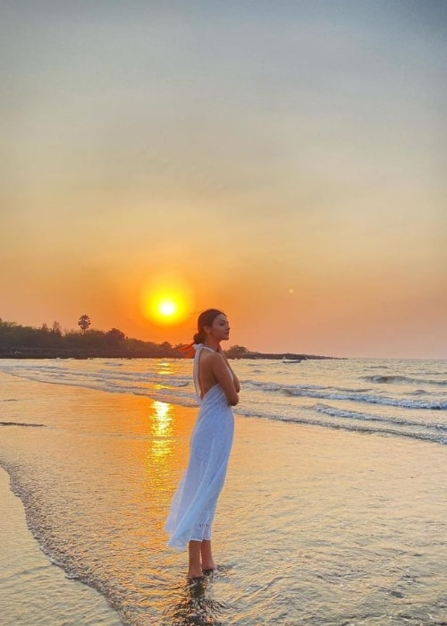 Pranali Rathod posing for a picture by a beach while enjoying a beautiful sunset in March 2021