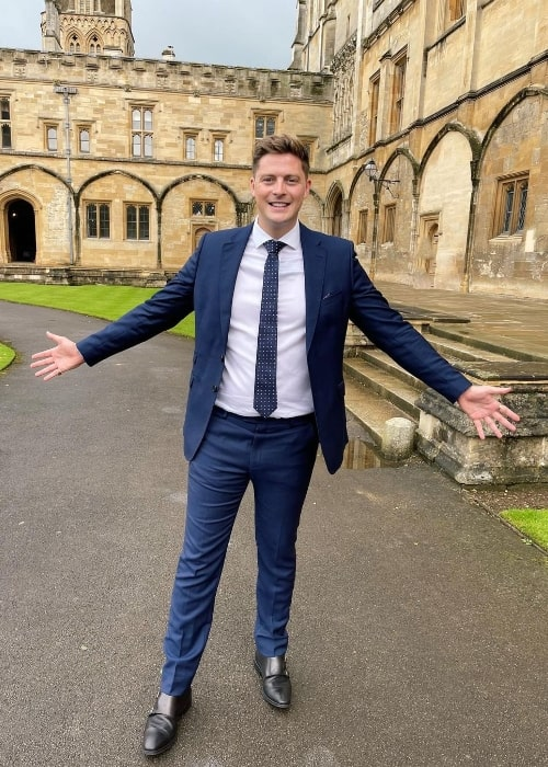 Alex George posing for a picture at Oxford University in August 2021