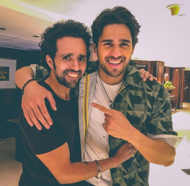 Anil Charanjeett (Left) as seen while smiling for a picture alongside his 'Shershaah' co-actor Sidharth Malhotra in August 2021
