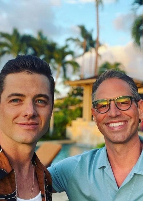 Greg Berlanti and Robbie Rogers, as seen in August 2021