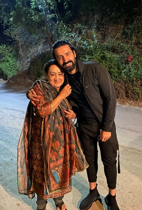 Karan Nath smiling in a picture alongside his mother in May 2021