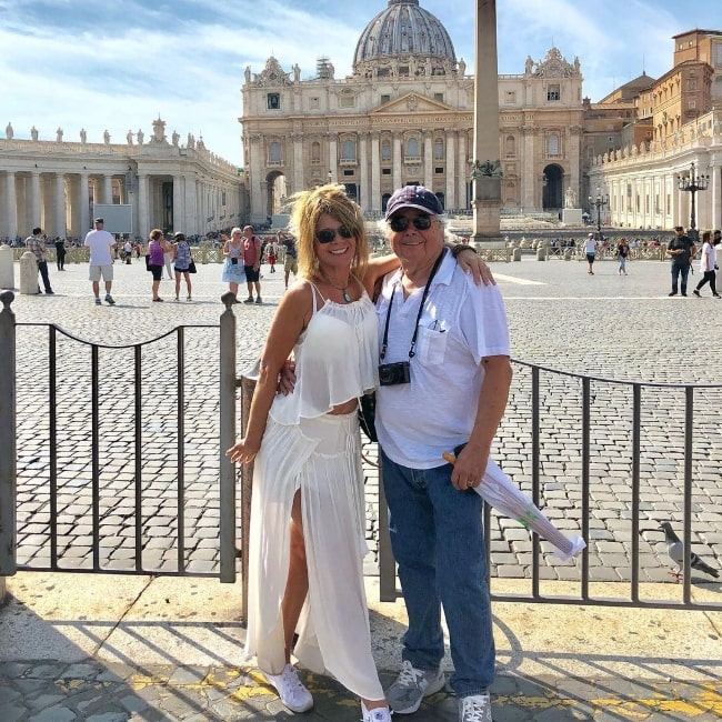 Mary-Margaret Humes and her husband Raul A. Bruce posing for the camera at Saint Peter's Square in Vatican City in 2018