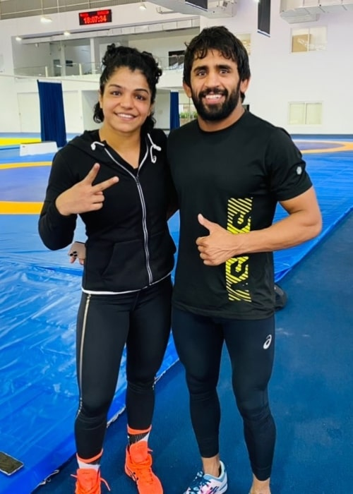 Sakshi Malik as seen in a picture that was taken in August 2021, with fellow wrestler Bajrang Punia