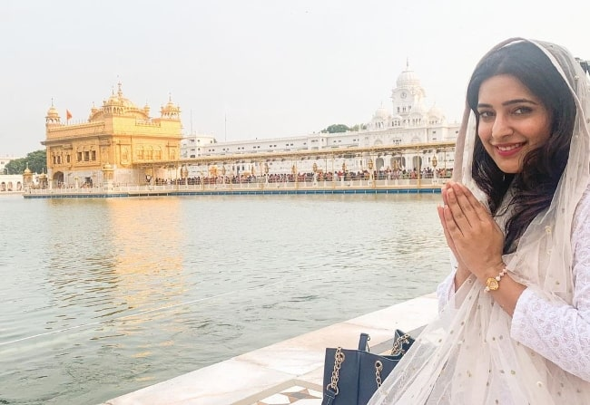 Shiny Dixit smiling for a picture at Golden Temple in Amritsar, Punjab in 2021