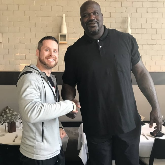 Troydan as seen in a picture with former professional basketball player Shaquille O'Neal in March 2018